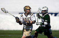 John Schiavone (39) of Loyola movies in on Robby Battle (20) of Navy at the Navy-Marine Corp Memorial Stadium in Annapolis, Maryland.   Loyola defeated Navy, 8-7, in overtime.