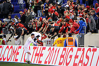 St. John's Red Storm players celebrate with fans after the match. St. John's defeated Villanova 2-0 during the second semifinal match of the Big East Men's Soccer Championships at Red Bull Arena in Harrison, NJ, on November 11, 2011.