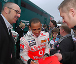 A young Williams F1 driver George Russell, possibly seeking Lewis Hamilton's autograph in 2009.