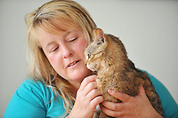 "Pictured: Lisa Darney from with ' Saffie' her cat which went missing for 8 years.<br /> Re: A family has been reunited with their cat eight years after she went missing.<br /> Saffie went missing from her home in Sandfields in Port Talbot in 2008 while her owner, Lisa Darney was away on holiday.<br /> The 44-year-old searched for years for Saffie, but was never able to find her and had begun to give up hoping that they would be reunited.<br /> But, earlier this week, Lisa received a phone call from a couple in Nant Y Moel in Bridgend who had found Saffie at their allotment.<br /> Now, Saffie has been reunited with her family.<br /> ""We got Saffie in 2005 as a Christmas present. She was only two months old at the time, and we absolutely adored her,"" Lisa said.<br /> ""I went away on holiday in September 2008 and I left my son to look after the animals, but she got out of the house and over the fence. We were devastated."