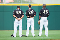 (L-R) Matt Tuiasosopo (29), Jordan Danks (20) and Michael Taylor (45) stand for the National Anthem prior to the game against the Scranton/Wilkes-Barre RailRiders at BB&T Ballpark on July 17, 2014 in Charlotte, North Carolina.  The Knights defeated the RailRiders 9-5.  (Brian Westerholt/Four Seam Images)