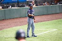 Liberty Flames coach Scott Jackson provides instruction during the game against the Duke Blue Devils in NCAA Regional play on Robert M. Lindsay Field at Lindsey Nelson Stadium on June 4, 2021, in Knoxville, Tennessee. (Danny Parker/Four Seam Images)