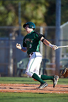 Dartmouth Big Green shortstop Nate Ostmo (5) hits a double during a game against the Northeastern Huskies on March 3, 2018 at North Charlotte Regional Park in Port Charlotte, Florida.  Northeastern defeated Dartmouth 10-8.  (Mike Janes/Four Seam Images)