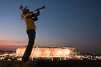 South African Nicholas Pilz blows a vuvuzuela outside Soccer City stadium before the FIFA World Cup first round match between Ivory Coast and Brazil in Johannesburg, South Africa on Sunday, June 20, 2010.