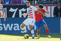 CARSON, CA - FEBRUARY 1: Sebastian Lletget #17 of the United States and Yeltsin Tejeda #17 of Costa Rica battle during a game between Costa Rica and USMNT at Dignity Health Sports Park on February 1, 2020 in Carson, California.