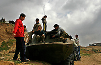 "Palestinain children playing on destroy ed Palestinian  tank  after isreal withdrawal from gaza strip.March.03.2008.""phto by Fady Adwan"""