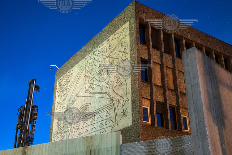 """Y-block, the former government building contains work of Picasso and Nesjar and the planned demolition is very unpopular.<br /> <br /> In the late 1950s and the early 1970s the Spanish artist Pablo Picasso designed five murals (The Beach, The Seagull, Satyr and Faun and two versions of The Fisherman) for the Regjeringskvartalet ('Government quarter') buildings in central Oslo, Norway.<br /> <br /> The designs by Picasso were executed in concrete by Norwegian artist Carl Nesjar, and were Picasso's first attempt at monumental concrete murals<br /> <br /> The modernist building, the Y-block, which formed part of the Norwegian government quarter for over fifty years. <br /> <br /> The building was drawn by architect Erling Viksjø and was finished 1969. Following the 2011 terror attack the building was left empty while the government have been mulling its' options. <br /> <br /> A decision on the fate of the murals was expected in early 2014. The murals were subsequently listed as one of Europe's most endangered heritage sites in 2015 by the heritage organisation Europa Nostra following the Norwegian cabinet's vote to demolish the Y-block building.<br /> <br /> In the beginning of 2020 the Norwegian government decided to tear down the building and redevelop the goverment quarter. <br /> <br /> The Architect's Newspaper writes: <br /> """"Demolition-ready government officials have vowed to save and relocate the murals, which were executed by Picasso's frequent collaborator, the Norwegian artist Carl Nesjar. Preservationists near and far, however, are crying foul. They believe that the building itself should also be spared from the wrecking ball.""""<br /> <br /> <br /> ©Fredrik Naumann/Felix Features"""