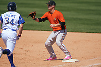 Frederick Keys first baseman Steve Laurino (28) waits for a throw as Roman Collins (34) runs up the base line during the first game of a doubleheader against the Wilmington Blue Rocks on May 14, 2017 at Daniel S. Frawley Stadium in Wilmington, Delaware.  Wilmington defeated Frederick 10-2.  (Mike Janes/Four Seam Images)