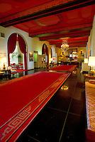 Gorgeous interior shot of the Royal Hawaiian Hotel lobby, showcasing the lush pink carpets.