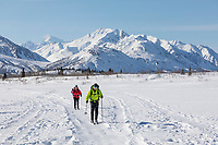 A copuple cross country skiing in the Alaska Range mountains.