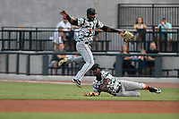 Second baseman Kelvin Beltre (13) of the Augusta GreenJackets falls as he goes for a pop fly in a game against the Columbia Fireflies on Saturday, July 29, 2017, at Spirit Communications Park in Columbia, South Carolina.  Right fielder Sandro Fabian (6) backs him up. Columbia won, 3-0. (Tom Priddy/Four Seam Images)