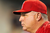 Los Angeles Angels manager Mike Scioscia (14) looks on from the dugout during the Major League Baseball game against the Detroit Tigers at Comerica Park on June 25, 2013 in Detroit, Michigan.  The Angels defeated the Tigers 14-8.  (Brian Westerholt/Four Seam Images)