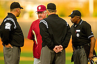 Florida State Seminoles head coach Mike Martin discusses a home run call with the umpiring crew during the game against the Wake Forest Demon Deacons at Wake Forest Baseball Park on March 24, 2012 in Winston-Salem, North Carolina.  The Seminoles defeated the Demon Deacons 3-2.  (Brian Westerholt/Four Seam Images)