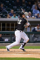 Matt Davidson (22) of the Charlotte Knights follows through on his swing against the Toledo Mud Hens at BB&T BallPark on April 27, 2015 in Charlotte, North Carolina.  The Knights defeated the Mud Hens 7-6 in 10 innings.   (Brian Westerholt/Four Seam Images)