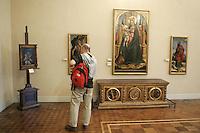 Un turista osserva alcuni dipinti nel Museo Poldio Pezzoli a Milano.<br /> A tourist admires paintings in the Museo Poldi Pezzoli in Milan.<br /> UPDATE IMAGES PRESS/Riccardo De Luca