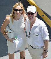 KEY BISCAYNE, FL - APRIL 05: Designer Tommy Hilfiger and wife Dee Ocleppo-Hilfiger arrive in their electric car to watch Novak Djokovic of Serbia defeat Andy Murray of Great Britain in the mens final during the Miami Open at Crandon Park Tennis Center on April 5, 2015 in Key Biscayne, Florida.<br /> <br /> <br /> People:  Tommy Hilfiger, Dee Ocleppo-Hilfiger<br /> <br /> Transmission Ref:  FLXX<br /> <br /> Must call if interested<br /> Michael Storms<br /> Storms Media Group Inc.<br /> 305-632-3400 - Cell<br /> 305-513-5783 - Fax<br /> MikeStorm@aol.com