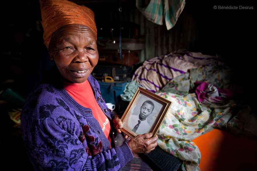 For HELP AGE (UK)<br /> <br /> 2010 - Nairobi, Kenya - Rhoda Ngima, 76 years old, holds a photograph of her grandson at her place in Gatina. Photo Credit: Benedicte Desrus