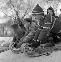 Montreal, CANADA. 1955 file photo.<br /> <br /> Kids on toboggan, winter 1955