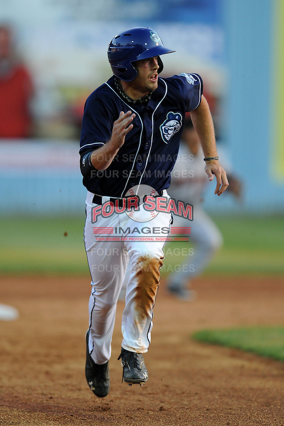 Asheville Tourists right fielder Brian Humphries #18 runs to third during a game between the Delmarva Shorebirds and the Asheville Tourists at McCormick Field, Asheville, North Carolina April 7, 2012. The Tourists won game one of a double header  8-4  (Tony Farlow/Four Seam Images)..