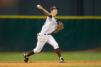Shortstop Adam Smith #20 of the Texas A&M Aggies makes a throw to first base versus the Rice Owls  in the 2009 Houston College Classic at Minute Maid Park February 28, 2009 in Houston, TX.  The Owls defeated the Aggies 2-0. (Photo by Brian Westerholt / Four Seam Images)