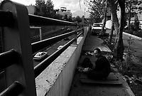 Teheran, Iran, April 25, 2007.A homeless man finishes his meager meal next to Kordestan highway in Northern Teheran.