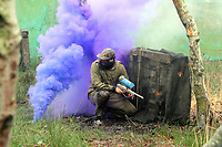 Pictured: One of the players throw back a smoke grenade.Tuesday 25 January 2011<br />