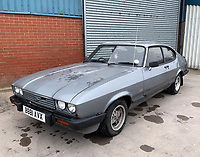 BNPS.co.uk (01202 558833)<br /> Pic: HampsonAuctions/BNPS<br /> <br /> Pictured: 1984 Ford Capri 1.6 Laser.<br /> <br /> Since the 1990s, Geoff Barlow, 46, has collected dozens of classic cars from an Escort Mexico replica to several types of Transit, Cortina, and Sierra.<br /> <br /> However, he still regrets selling the first car which inspired his passion, a 1980 Escort Mark 2 he bought from his sister in 1992.  <br /> <br /> Geoff's fascination with Fords gathered pace in the last decade and he 'lost control,' buying as many Fords as he came across and saving them from disrepair.