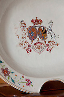 Detail of one of the chafing dishes on display on the dining room fireplace; the coat of arms now a little worn away