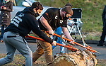 BEACON FALLS, CT-112020JS12—Luke Cybulski and captain Tyler Smith, both members of the Woodland Timber Team, compete in the log roll competition during the Battle Royal Friday at Woodland Regional High School.<br />  Jim Shannon Republican-American