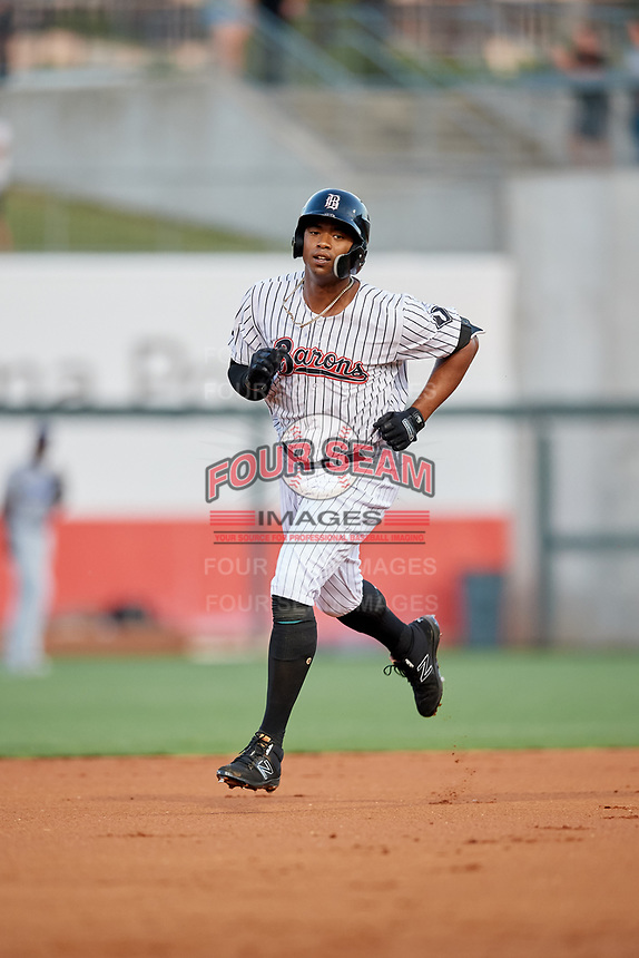 Birmingham Barons left fielder Eloy Jimenez (21) rounds the bases after hitting a home run in the bottom of the first inning during a game against the Pensacola Blue Wahoos on May 8, 2018 at Regions FIeld in Birmingham, Alabama.  Birmingham defeated Pensacola 5-2.  (Mike Janes/Four Seam Images)