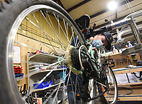 BIKES FOR ALL<br />Elder Zane Young, a volunteer with Pedal It Forward, repairs a bicycle on Saturday Nov. 14 2020 at the Pedal It Forward workshop in Rogers. Pedal It Forward provides bicycles to any adult or youngster who needs a bike. Volunteers assemble and repair donated bicycles at workshops in Rogers and Bentonville, said Eric Kinnison, assistant director at Pedal It Forward. The group will open a workshop soon in Joplin, Mo., Kinnison said. Go to nwaonline.com/201115Daily/ to see more photos.<br />(NWA Democrat-Gazette/Flip Putthoff)