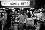 """Television and radio repair shop. """"Get Money Here"""", they also bought and sold secondhand TV sets. 1972 Queensway, London. 1970s UK."""