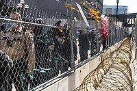 The Hennepin County Sheriff's remove the photos and locks with the names written on them who were killed by police from the fencing outside the Hennepin County Government Center on April 2, 2021 in Minneapolis, Minnesota. Protestors have not left the space in Government Plaza  since the beginning of the trial on Monday and placed the locks and artwork on the fence in memory of the lives lost and to remind people that the trial is going on as they pass by.  <br /> CAP/MPI/IS/CT<br /> ©CT/IS/MPI/Capital Pictures