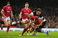 Wales Hadleigh Parkes is tackled by Barbarians Andre Esterhuizen during the International friendly match between Wales and Barbarians at the Principality Stadium in Cardiff, Wales, UK. Saturday 30 November 2019.