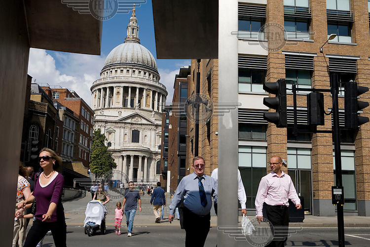 St. Paul's Cathedral towers above city workers and visitors to the City of London.