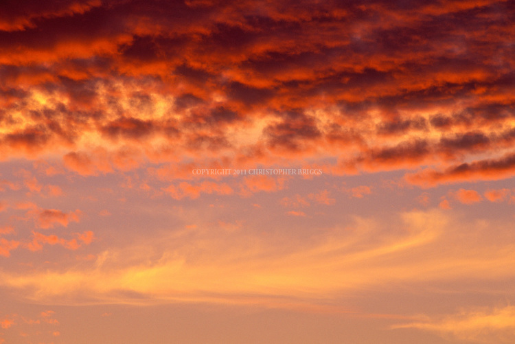 Clouds lit from below at sunset create a colorful display.