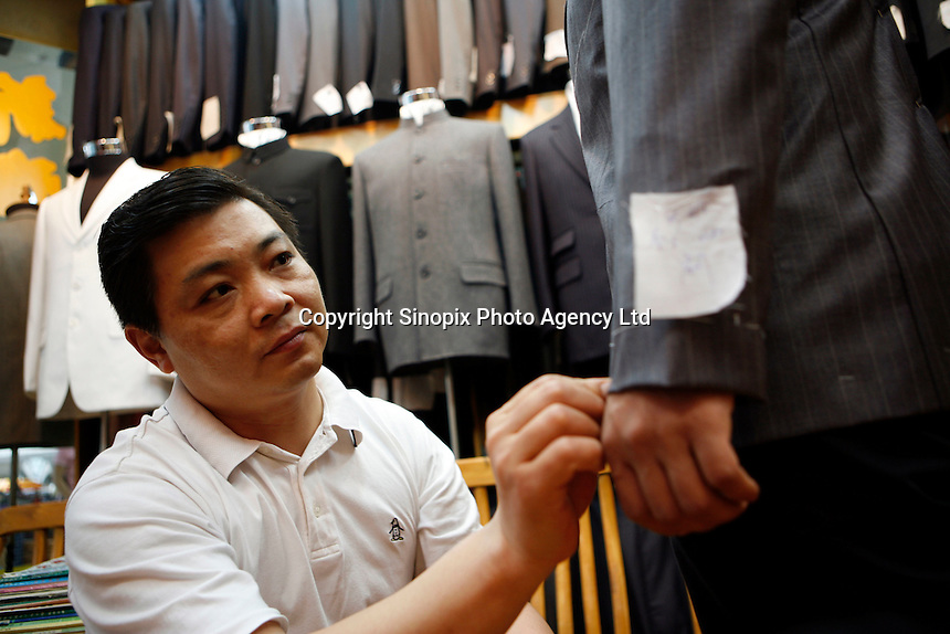 A tailor shop in the Lowu Commercial center in Shenzhen, China, a popular shopping center for locals and tourists alike at the Lowu border crossing between Shenzhen and Kong Kong. Here a tailor made suit can be made for a slow as $80USD and can be ready in 24 hours..Sep 2006