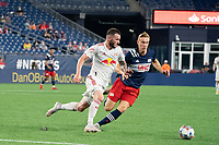 FOXBOROUGH, MA - MAY 22: Adam Buksa #9 of New England Revolution comes in to tackle Thomas Edwards #7 of New York Red Bulls during a game between New York Red Bulls and New England Revolution at Gillette Stadium on May 22, 2021 in Foxborough, Massachusetts.
