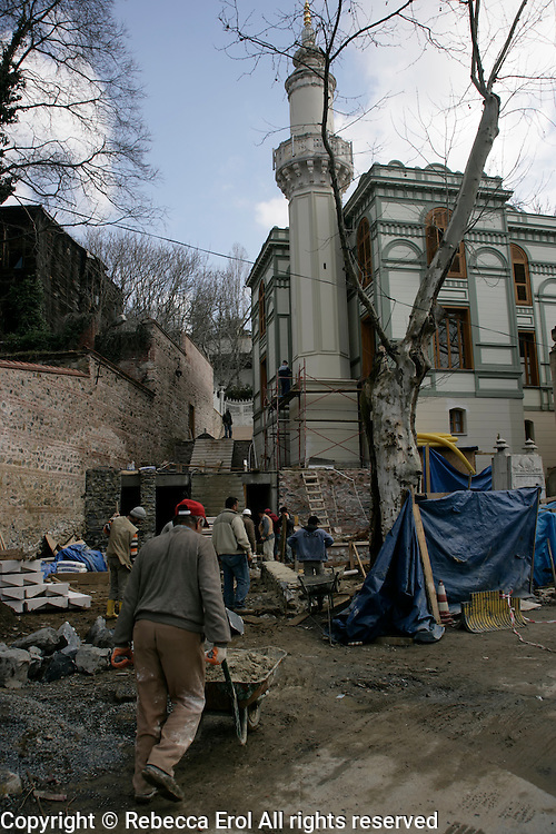 Workmen working on the restoration of the Seyh Zafir Mosque in Besiktas, Istanbul, Turkey