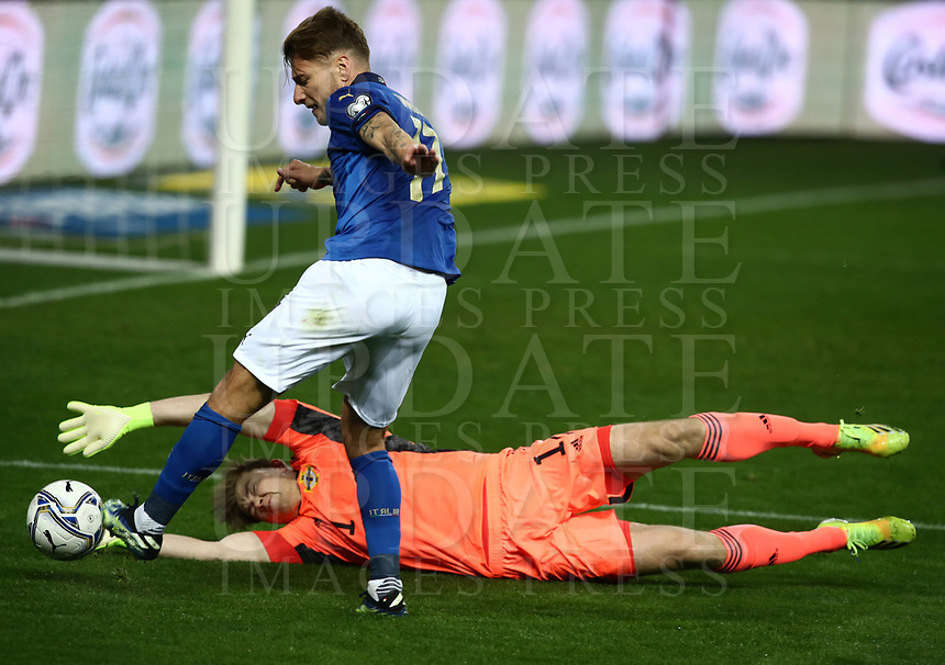 Footbal Soccer: FIFA World Cup Qatar 2022 Qualification, Italy - Northern Ireland, Ennio Tardini stadium, Parma, March 26, 2021.<br /> Italy's Ciro Immobile (L) in action with Northern Ireland's goalkeeper Bailey Peacock-Farrell (R) during the FIFA World Cup Qatar 2022 qualification, football match between Italy and Northern Ireland, at Ennio Tardini stadium in Parma on March 26, 2021.<br /> UPDATE IMAGES PRESS/Isabella Bonotto