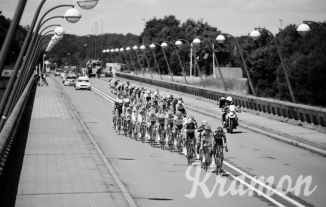 As the peloton hits the bridge over the Lacs de l'eau d'Heure the wind blows (from the left) the peloton in 2 echelons. Race leaderNiki Terpstra (NLD/Etixx-QuickStep) is about to cross from the 2nd into the first echelon at this point. The echelon has no further influence on the race as the wind subsides as soon as they leave the (long) bridge. <br /> <br /> Tour de Wallonie 2015<br /> stage 5: Chimay - Thuin (167km)