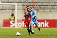 HARRISON, NJ - FEBRUARY 26: Alexandru Mitrita #28 of NYCFC battles for the ball with Roberto Cordoba #11 of AD San Carlos during a game between AD San Carlos and NYCFC at Red Bull on February 26, 2020 in Harrison, New Jersey.