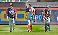 25 July 2012: Washington Nationals starting pitcher Stephen Strasburg (center) returns to the dugout after warming up along with catcher Sandy Leon (right) and pitching coach Steve McCatty (left) prior to a game against the New York Mets at Citi Field in Flushing, NY. The Nationals defeated the Mets 5-2 to sweep their 3-game series. Mandatory Credit: Ed Wolfstein Photo