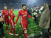 Pictured: Olympiacos players walk off the pitch at Toumba Stadium in Thessaloniki, Greece. Sunday 25 February 2018<br /> Re: Sunday's Greek Super League derby between PAOK Thessaloniki and Olympiakos was called off after Olympiakos' manager Oscar Garcia was struck in the face by an object believed to be a till machine paper roll, thrown by a spectator minutes before kick-off.<br /> Garcia left Toumba Stadium for a local hospital to seek treatment for a bloodied lip.<br /> The incident prompted the Olympiakos team to leave the pitch in protest before riots erupted outside the ground.<br /> Angry PAOK fans leaving the stadium then clashed with police who used tear gas to quell the violence.