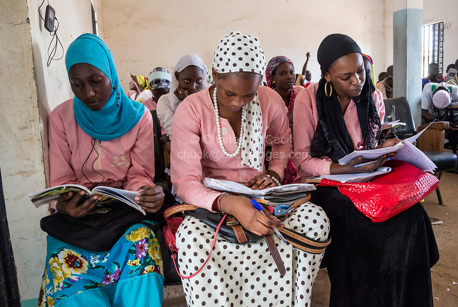 Senegal, Touba.  Young Women Reading their Lessons at the Al-Azhar Institute of Islamic Studies.