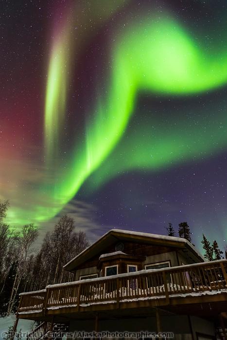 The aurora borealis hovers over a home in Fairbanks, Alaska.