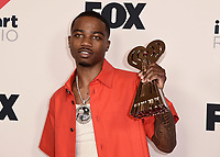 """HOLLYWOOD, CA - MAY 27:  Roddy Ricch with the award for Best New Hip Hop Artist at the 2021 """"iHeartRadio Music Awards"""" airing live from The Dolby Theatre in Los Angeles, Thursday, May 27 (8:00-10:00 PM ET live / PT tape-delayed) on FOX. CR: Scott Kirkland/FOX/PictureGroup © 2021 FOX MEDIA, LLC. (Photo by Scott Kirkland/FOX/PictureGroup)"""