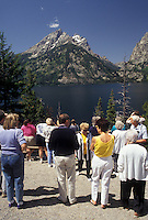 AJ3576, Grand Teton National Park, Lake Jenny, Grand Teton, Rocky Mountains, Wyoming, A group of tourists stand at the Lake Jenny overlook to view the scenery of the lake and the majestic Teton mountain range of Grand Teton National Park in the state of Wyoming.