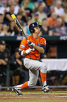 Cal State Fullerton Titans outfielder Josh Vargas (40) follows through on his swing during the NCAA College baseball World Series against the Vanderbilt Commodores on June 14, 2015 at TD Ameritrade Park in Omaha, Nebraska. The Titans were leading 3-0 in the bottom of the sixth inning when the game was suspended by rain. (Andrew Woolley/Four Seam Images)