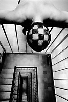 Switzerland. Geneva. View inside a modern architectural building. Checkerboard's haircut. The head belongs to my friend Lorenzo Menoud. © 1988 Didier Ruef